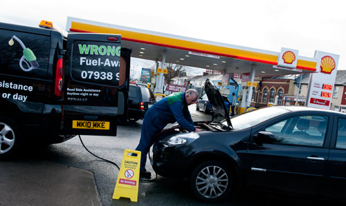 Draining a petrol tank in Neston